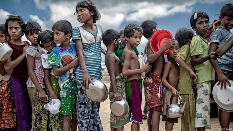 Rohingya refugee children queue for food in a camp in Cox's Bazar, Bangladesh   Photo: K.M.Asad
