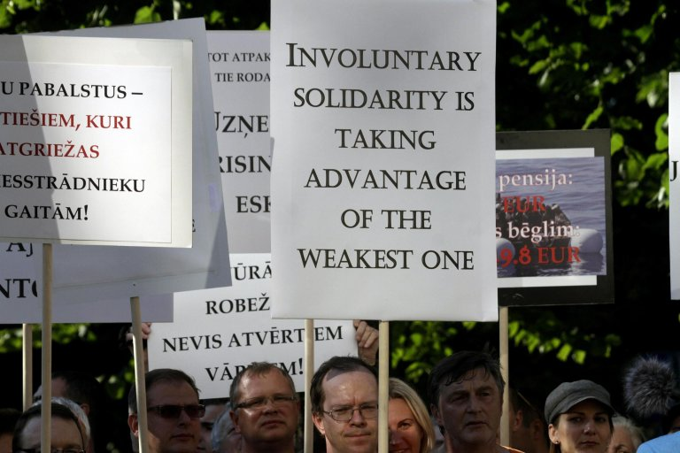ANSA / احتجاج مناهض للهجرة في ريغا بلاتفيا. المصدر: إي بي إيه/ فالدا كالنينا.