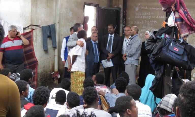 Mohammed Abdiker (r) and next to him, Sarat Dash (l) IOM Yemen Chief of Mission (both wearing ties) listen to migrants in Sana'a, Yemen. Credit: IOM