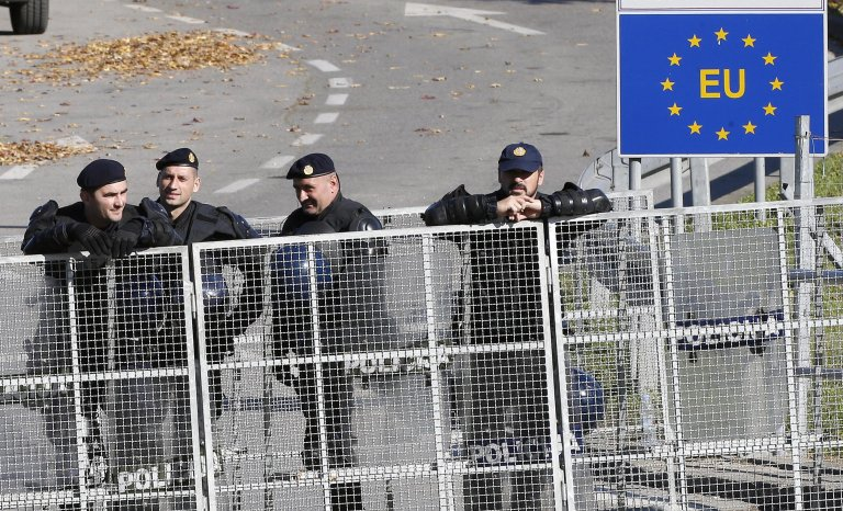 Croatian border policemen at Maljevac border crossing with Bosnia as a group of migrants attempt to cross into Croatia. PHOTO/ARCHIVE/EPA/FEHIM DEMIR