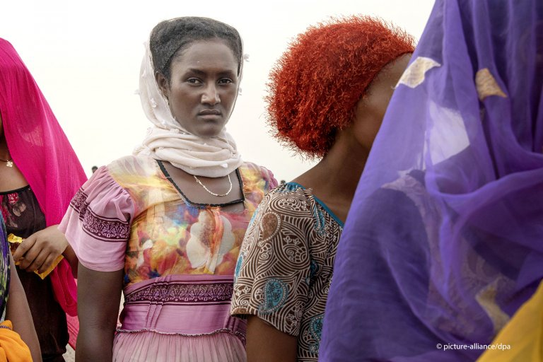 Ethiopian Tigray migrants stand in line as they are counted by smugglers after arriving in Yemen
