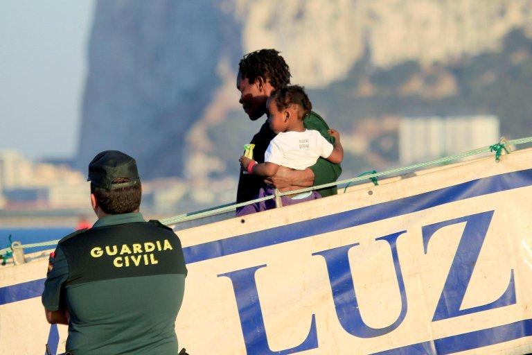 Migrants disembark in the port of San Roque, Cadiz, Spain.Credit: EPA/A.CARRASCO RAGEL