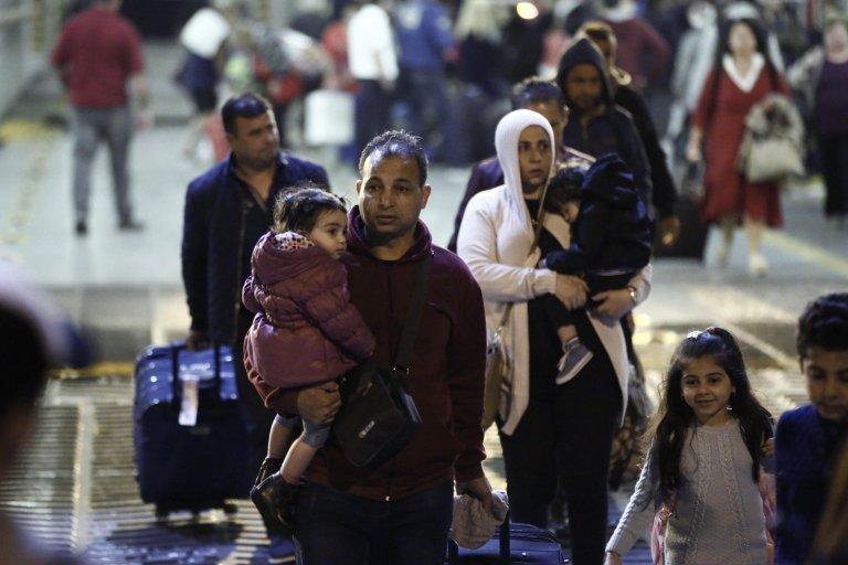 Refugees arriving in Piraeus from the Greek island of Samos. Photo | EPA/YANNIS KOLESIDIS