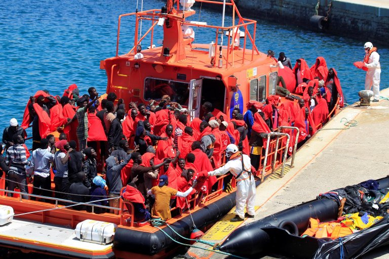 This picture shows some of the 238 Sub-Saharan migrants rescued in the waters of the Strait of Gibraltar, while trying to reach the Spanish coast on board 20 small boats, arriving at the port in Cadiz, Andalusia, southern Spain on July 24. Photo/EPA/Carrasco Ragel