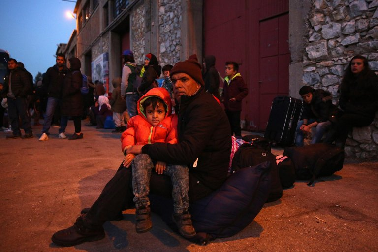 Refugees wait for transport after arriving on the ferry 'Nissos Samos' from Lesvos island at the port of Piraeus, Greece, 11 December 2017. EPA/ORESTIS PANAGIOTOU