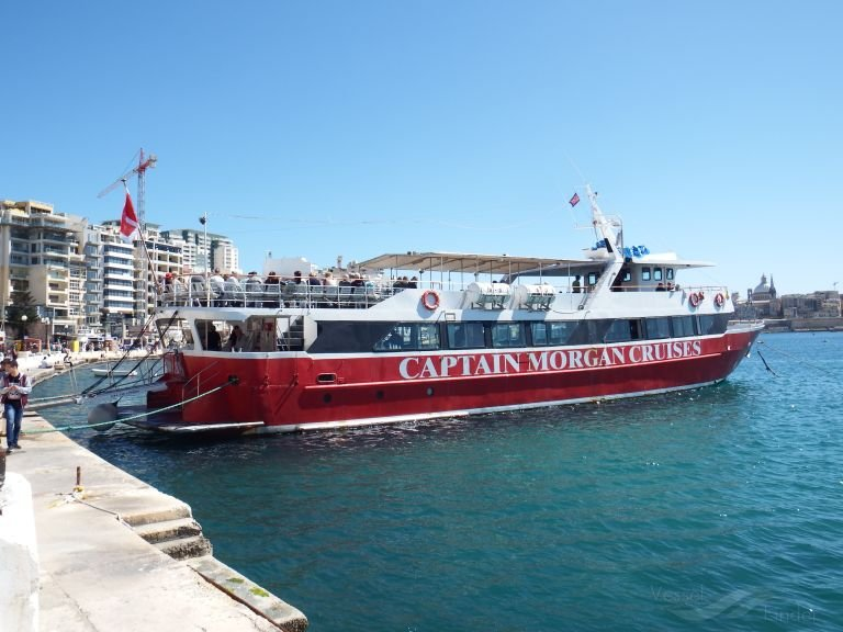 """A tourist boat of the """"Captain Morgan Cruises in the harbor of Valletta, the capital of Malta 