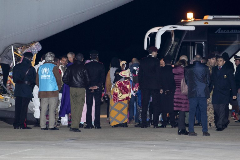 Migrants arriving from Libya to the Italian military airport of Pratica di Mare near Rome, thanks to humanitarian corridors. Credit: ANSA/MASSIMO PERCOSSI