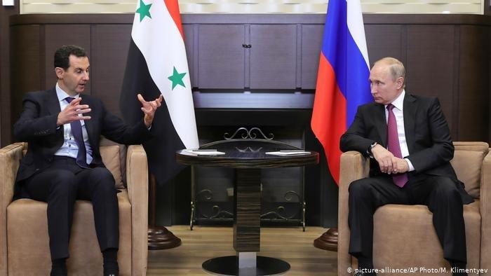 صورة من الأرشيف للرئيس الروسي بوتين والرئيس السوري بشار الأسد
