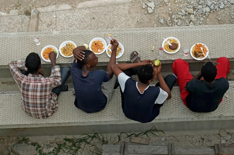 Migrants waiting to be hosted at a permanent facility   Phot: ANSA archive/ Alessandro Di Meo