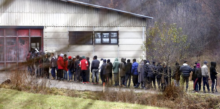 Migrants at a military barracks in Blazuj, on the outskirts of Sarajevo, Bosnia-Herzegovina, 12 December 2019. Migrants were transferred to the military barracks after Bosnian officials closed a makeshift tent camp in Vujcak, near Bihac, due to disastrous conditions at the camp | Photo: EPA/FEHIM DEMIR