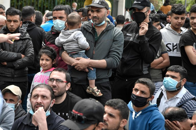 Migrants protesting outside the EU offices in Athens on May 27, 2020 | Photo: Louisa GOULIAMAKI / AFP