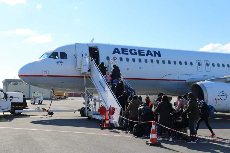 From file: A flight from Lesbos brings refugees to Hanover in Germany | Source: IOM Greece Twitter feed @IOMGREECE