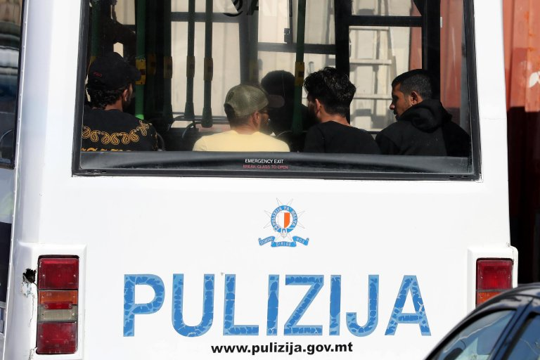 Migrants enter a Maltese police bus after disembarking the Maltese Armed Forces of Malta patrol boat P52 at the the Armed Forces of Malta base at Hay Wharf, in Floriana, Malta, 30 September 2018 | Photo: EPA/DOMENIC AQUILINA