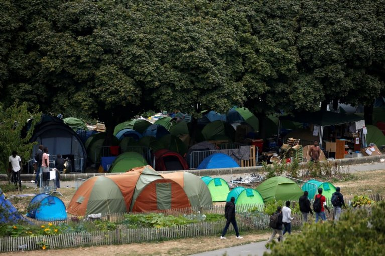 An illegal tent camp is dismantled near the western city of Nantes. Photo: Reuters