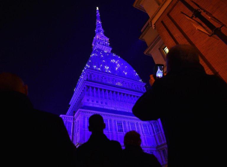 The Mole Antonelliana lit up for Christmas in Turin   Photo: ANSA/Alessandro di Marco