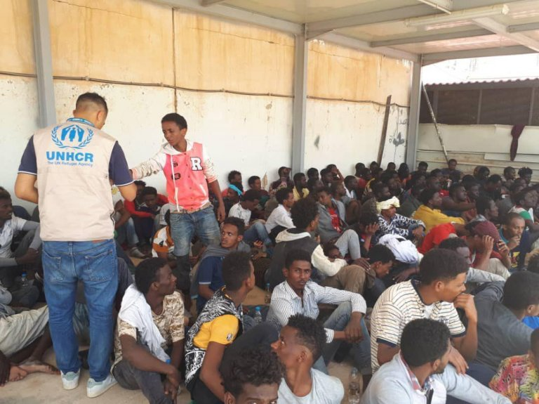 UNHCR personnel assisting migrants in Tripoli who had survived the sinking of their ship off the Libyan coast | Photo: ANSA/UNHCR