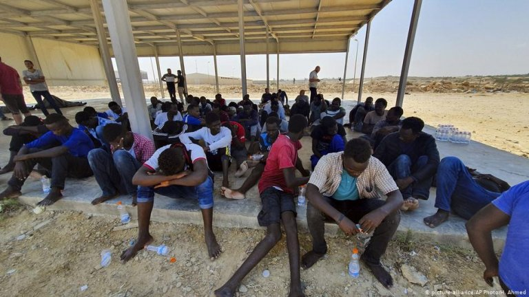 The surviving migrants seen here reported hearing screaming and crying from the capsized boat   Photo: Picture-alliance/AP Photo/H. Ahmed