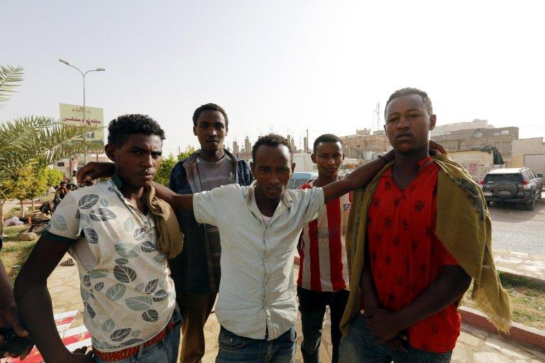 African migrants gather beside a road in the eastern city of Marib, Yemen | Photo: EPA/YAHYA ARHAB