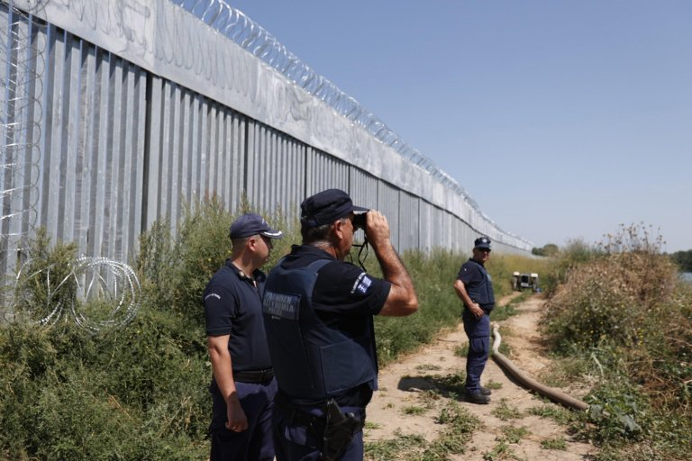 Police officers patrol along a steel fence built at Evros River in the area of Feres, at the Greek-Turkish border, Greece, 22 August 2021   Photo: EPA/DIMITRIS TOSIDIS
