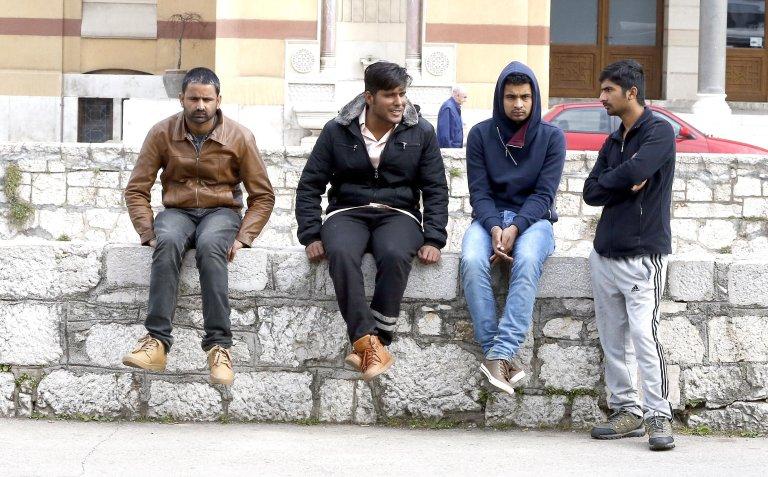 Migrants in a park in Sarajevo, Bosnia | Credit: EPA/ Fehim Demir