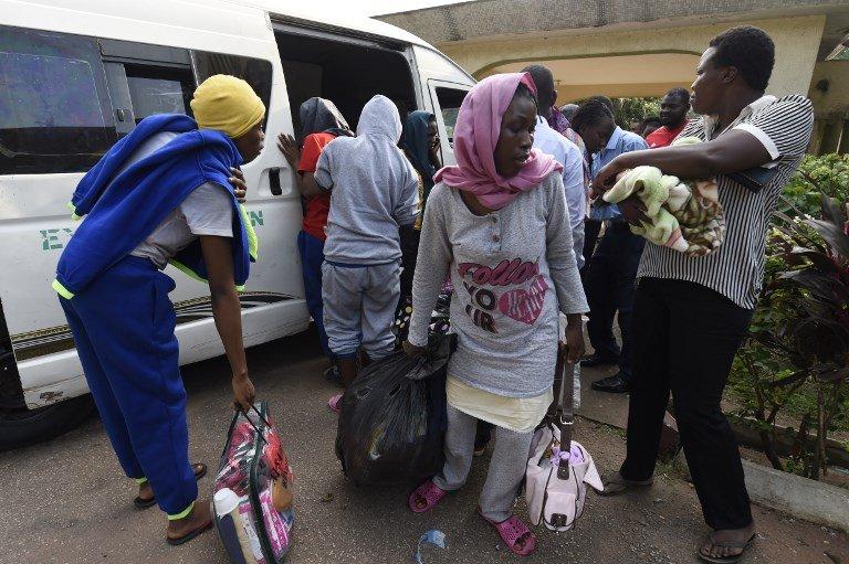 PIUS UTOMI EKPEI / AFP  Des migrants nigérians revenus de Libye arrivent à Benin City, capitale de l'Etat d'Edo, en décembre 2017.