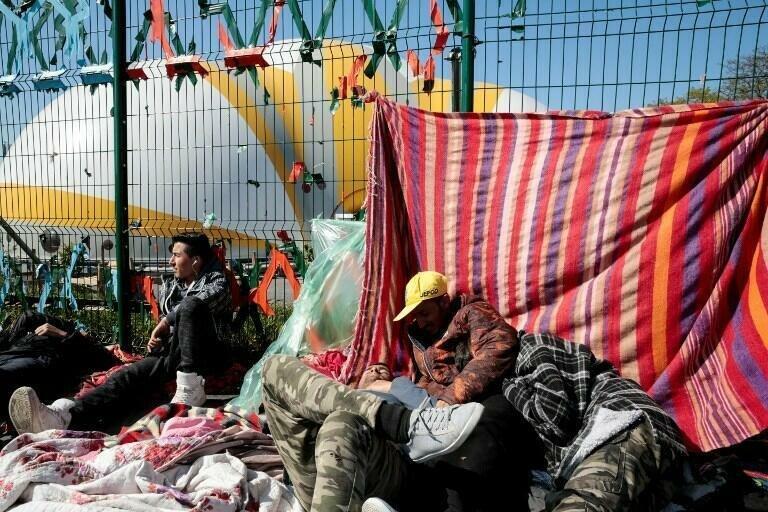 Des migrants afghans à l'entrée d'un camp de migrants, porte de la Chapelle à Paris (archives). Crédit : AFP