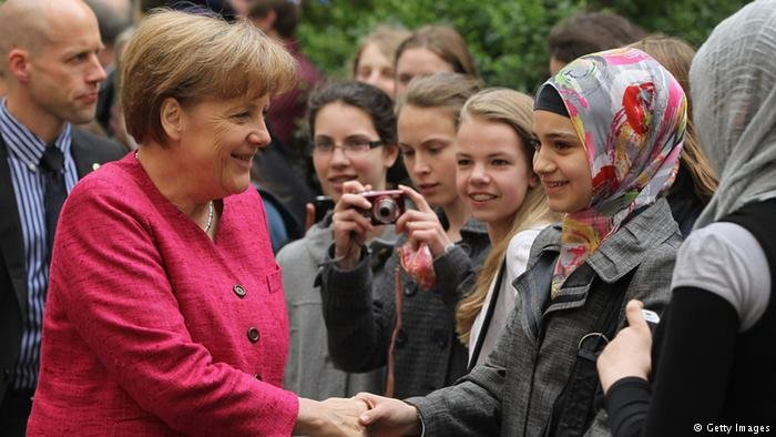 While promising to curb migration, Merkel also had positive words for Muslims in Germany