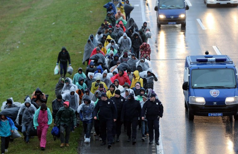 Hundreds of migrants march from Belgrade to the Croatian border on the highway Belgrade-Zagreb near Pecinci 50km from Belgrade, Serbia, 12 November 2016. EPA/KOCA SULEJMANOVIC
