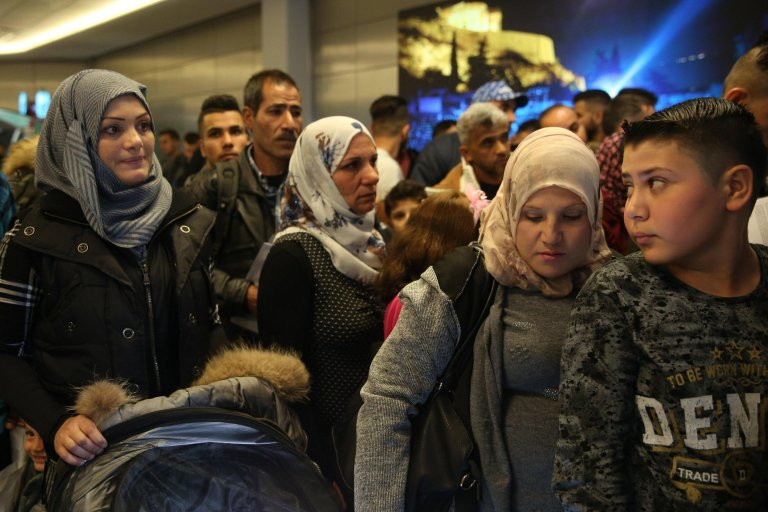 Refugee families at Athens' airport. Credit: EPA/ORESTIS PANAGIOTOU