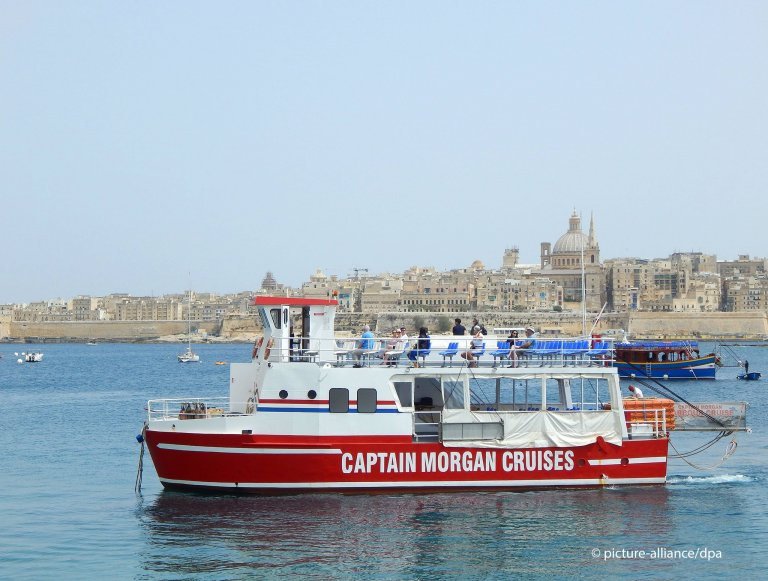 "The migrants have been confined to two ""Captain Morgan"" tourist boats for more than two weeks 