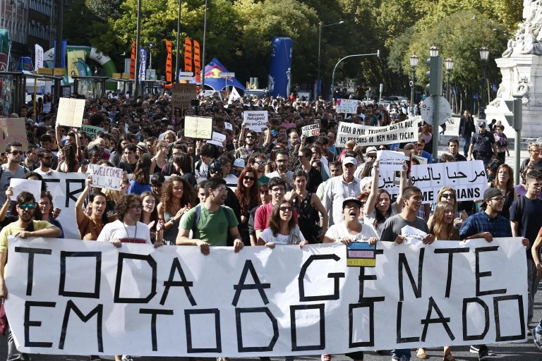 """A demonstration in support of migrants in Lisbon - placards say: """"Everybody everywhere"""" 