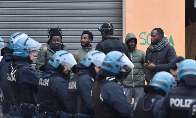 Police supervise the clearing of one of the buildings of the ex Olympic Village in via Giordano Bruno in Turin. Credit: ANSA/ALESSANDRO DI MARCO