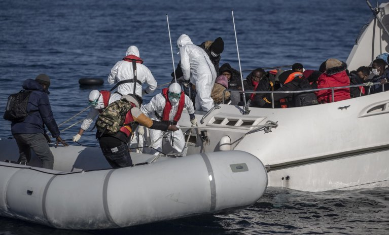 From file: Members of the Turkish Coast Guard take migrants, who were allegedly pushed back from the Greek side, on a boat during a patrol to search and rescue for migrants offshore the Ayvalik district in Balikesir, Turkey, April 10 2021   Photo: Erdem Sahin / EPA