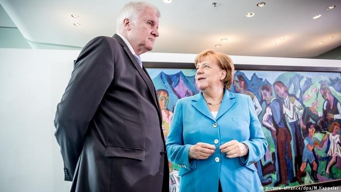 Chancellor Angela Merkel and Interior Minister Horst Seehofer | Credit: picture-alliance/dpa/M. Kappeler