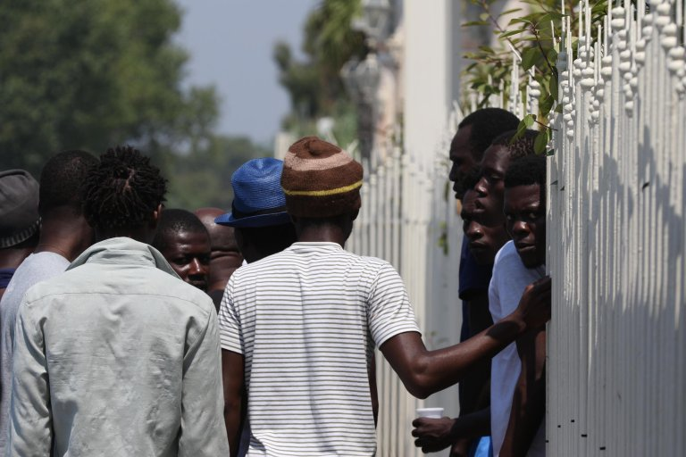 A group of migrants along the Domiziana state road in Giugliano in the province of Naples   ANSA/CESARE ABBATE