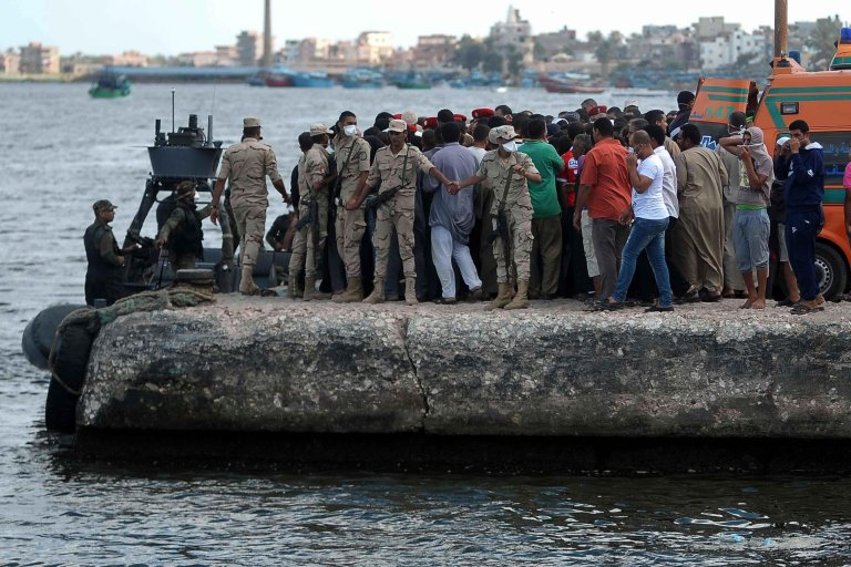 Families of missing people gather on a pier at the Port of Rosetta in Egypt after a boat carrying migrants capsized off the shore. Credit: EPA/TAREK ALFARAMAWY