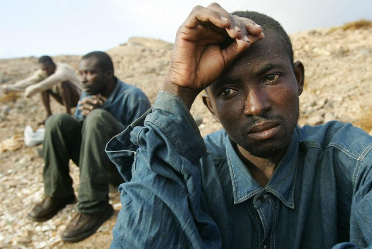 Three undocumented immigrants from sub-Saharan Africa abandoned in the desert by Moroccan authorities in an archive photo. ANSA/ARCHIVE