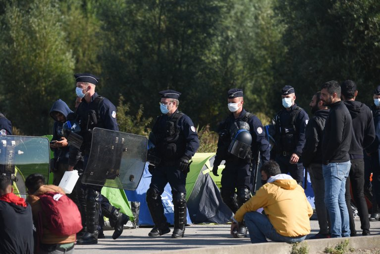 French police regularly raid and 'evacuate' informal migrant camps in and around Calais | Photo: Reuters