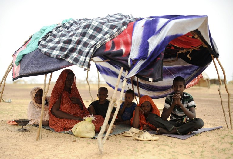A family from Mali sitting under a tent at a refugee camp near Dori, Burkina Faso. PHOTO/ARCHIVE/EPA/HELMUT FOHRINGER