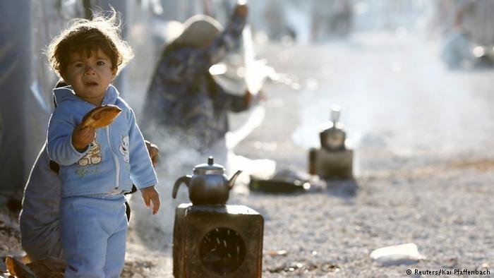 Syrian refugee child | Photo: Reuters/Kai Pfaffenbach