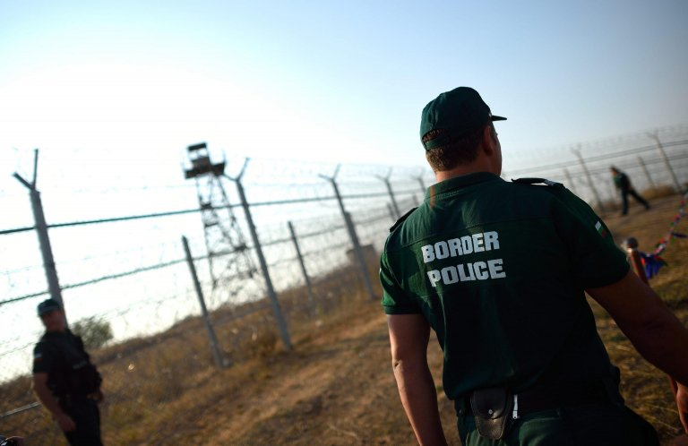 Bulgarian border police secure the fence on the border between Turkey and Bulgaria at the checkpoint of Lesovo, some 350 km from Sofia. Credit: EPA/VASSIL DONEV