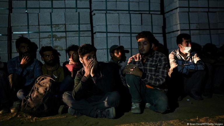 Afghan refugees awaiting transport by smugglers into Turkey   Photo: Ozan Kose/AFP/Getty Images