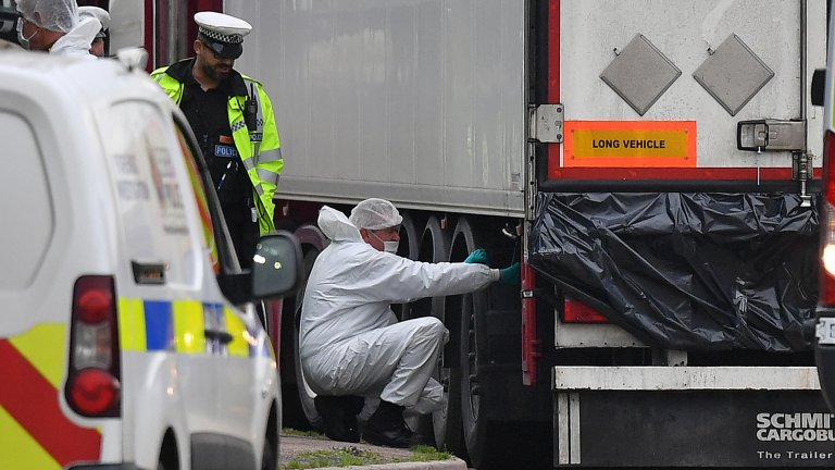 © Ben Stansall, AFP (file photo) | British Police forensics officers work on the lorry that was found to contain the 39 dead bodies, at Waterglade Industrial Park in Grays, east of London, on October 23, 2019.