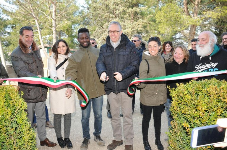 "The Governor of the central Marche region in Italy, Luca Ceriscioli, and the Councillor for development and industry, Manuela Bora, participate in the inauguration of the Museum of Farming and local traditions at Jeffery Eromosele Osoiwanlan's ""Country Farm"" in Montecarotto, Ancona. Osoiwanlan, 33, a Nigerian obtained political refugee status after arriving in Italy on a migrant boat in 2015. He was fleeing Boko Haram terrorists 