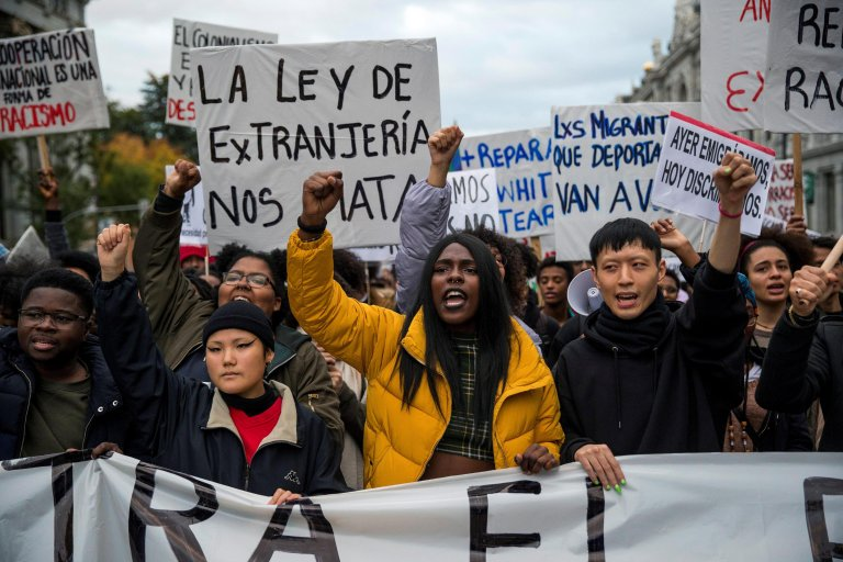 People shout slogans during a demonstration called by SOS Racism organization under the slogan 'Against institutional racism' in Madrid, Spain. Photo: EPA/RODRIGO JIMENEZ