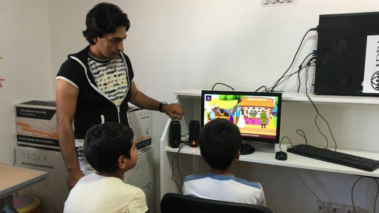 Karim, 29, teaches kids at a charity organization as a volunteer.  Credit : Julia Dumont