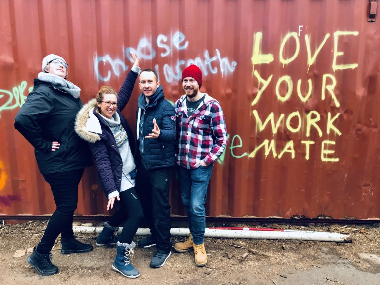 Sol Escobar, second from left, with colleagues from the Cambridge Assessment Refugee Support Committee, Hannah, Pete and Lee | Photo: Courtesy of Sol Escobar