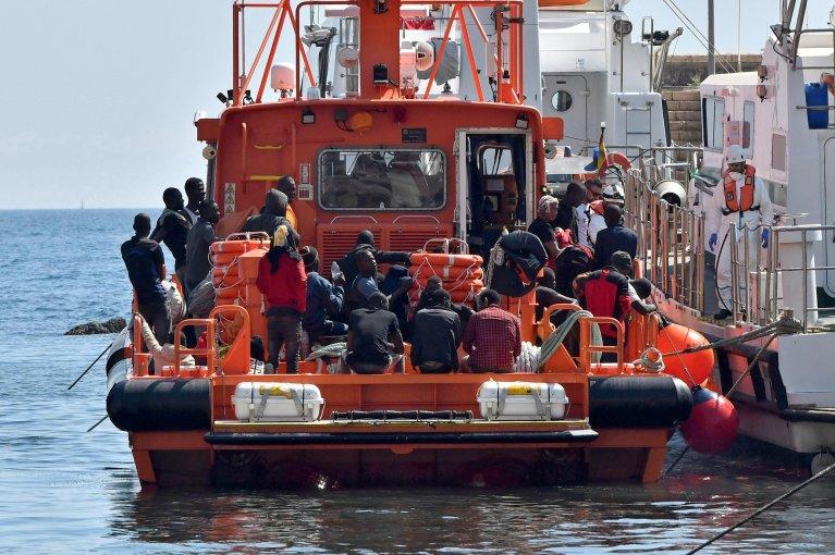 Migrants are taken to the port of Almeria after being rescued in the Alboran Sea, in Almeria, southeastern Spain. Credit: EPA/CARLOS BARBA