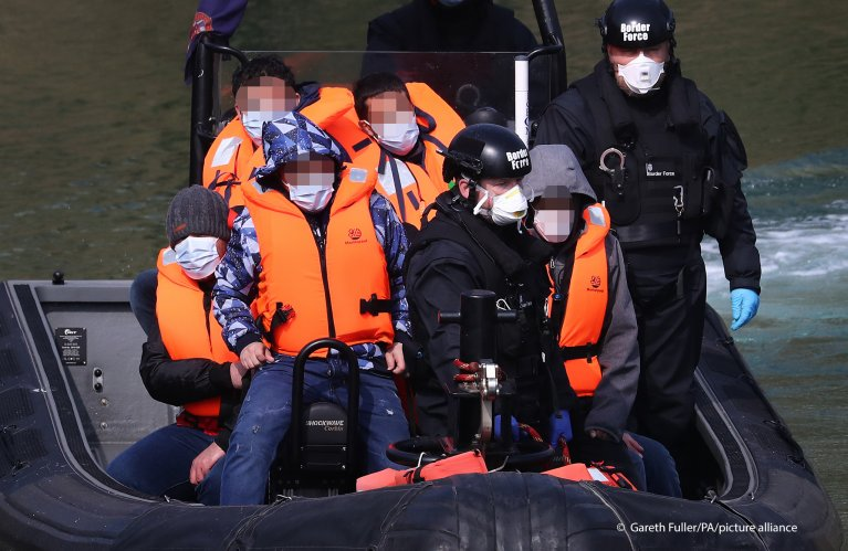 From file: A group of people thought to be migrants are brought in to Dover, Kent, by Border Force officers following a small boat incident in the Channel, April 20, 2021 | Photo: Gareth Fuller/PA Wire