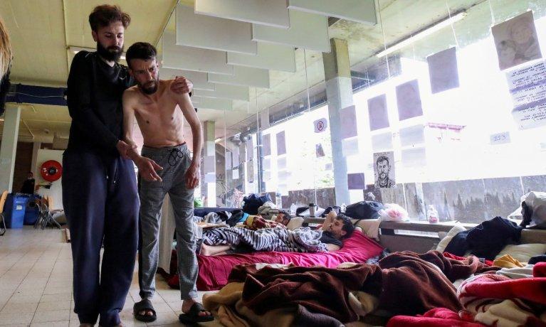 Plus de 450 personnes sans-papiers sont toujours en grève de la faim depuis plus d'un mois à Bruxelles, le 2 juillet 2021. Crédit : REUTERS/Yves Herman REFILE